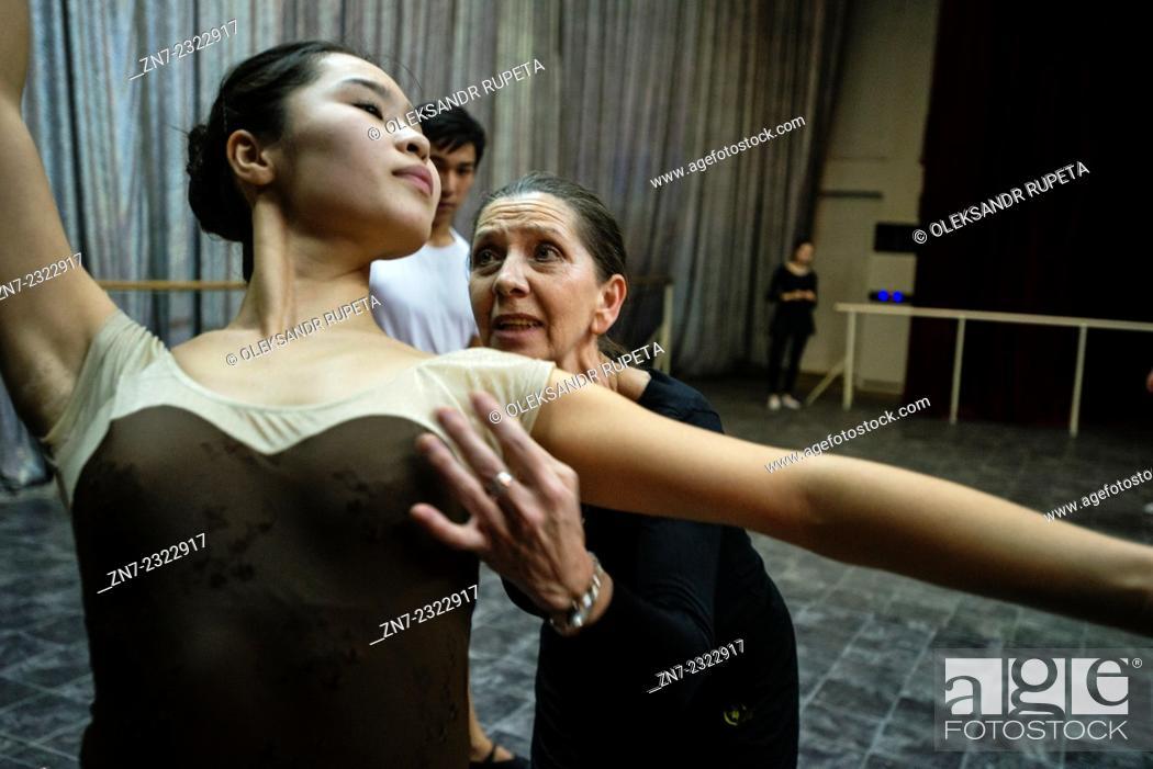 Stock Photo: Teacher Aksenova Irina Sergeevna trains ballerina during rehearsal of the Waltz of the Flowers, the part of the Nutcracker, ballet scored by Pyotr Tchaikovsky.