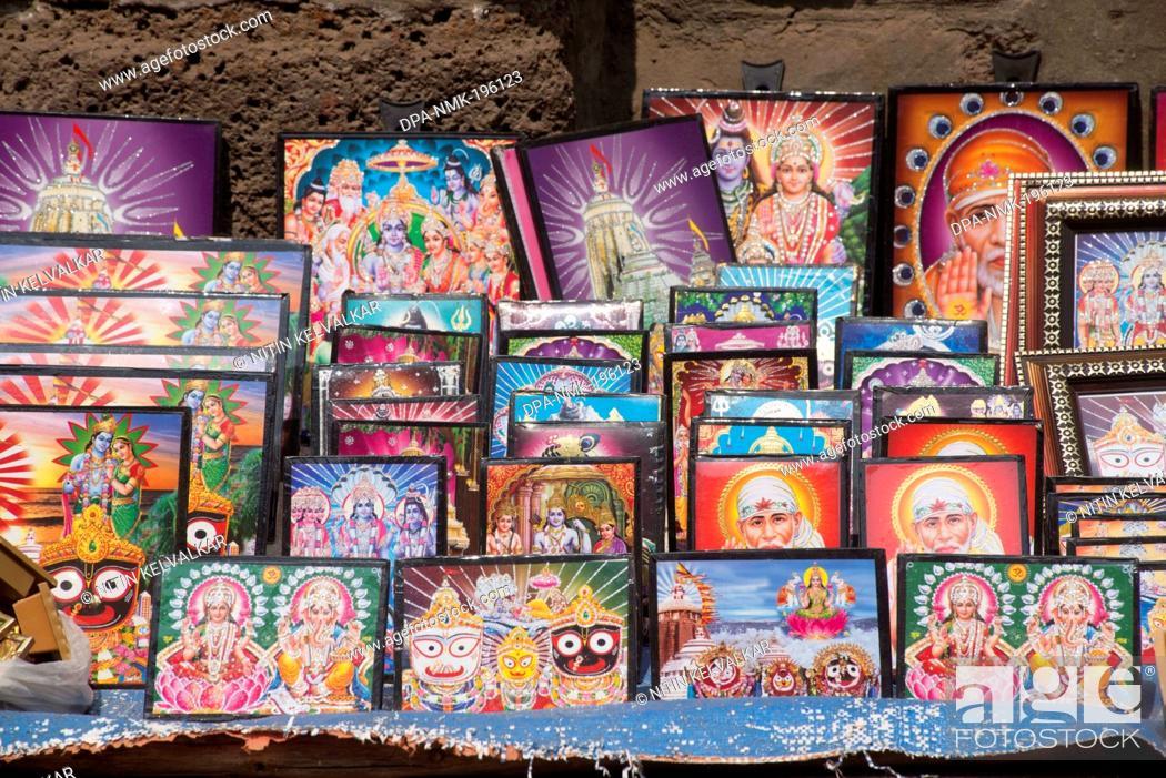Laminated photo frames of gods kept for sell, puri, orissa, india ...
