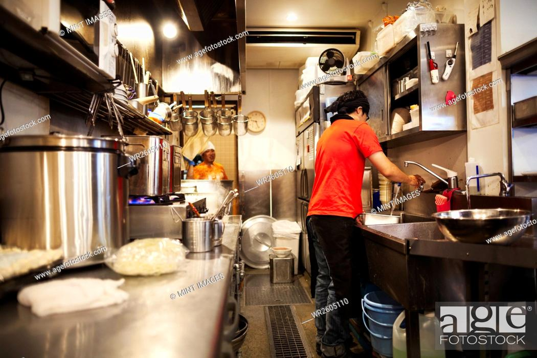 The Ramen Noodle Shop A Chef Working In A Kitchen Preparing Food Using A Stove And Large Pans Stock Photo Picture And Royalty Free Image Pic Wr2605110 Agefotostock