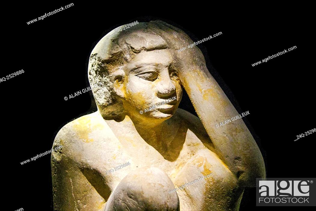 Stock Photo: Egypt, Alexandria, National Museum, model statuette of a servant cooking and protecting his head from fire.