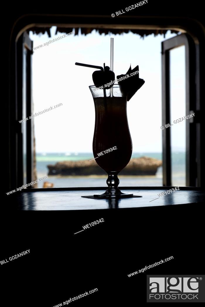 Stock Photo: Tropical Drink Silhouette - Hemingways Resort - Watamu, Kenya.