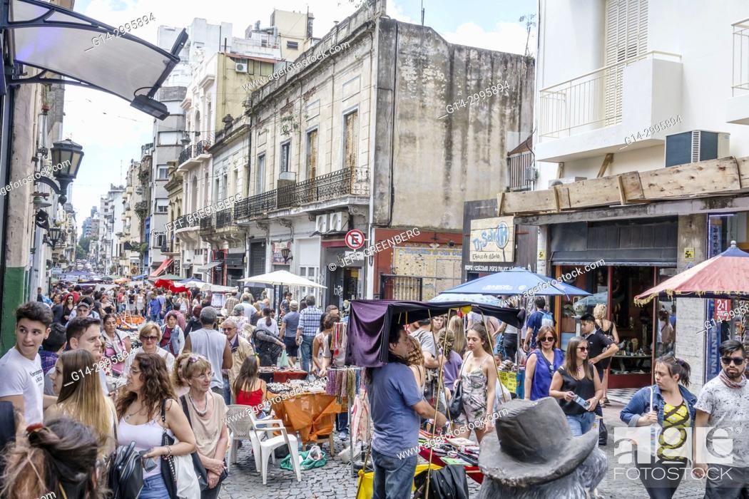Stock Photo: Argentina, Buenos Aires, San Telmo, art fair, marketplace vendors vendor booths stalls, shopping, antiques, man, woman, crowded, Hispanic.