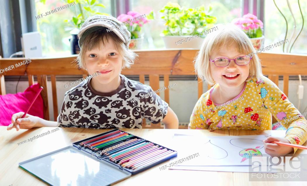 Stock Photo: Girl and boy drawing.