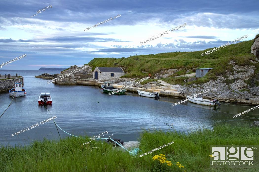 Stock Photo: Sunset at Ballintoy Harbour Marina in Northern Ireland.