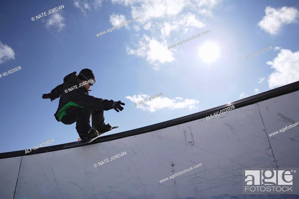 Stock Photo: Snowboarder Railsliding.