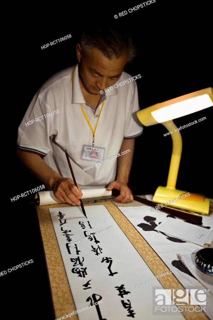 Stock Photo: Mature man doing calligraphy, Temple of Confucius, Qufu, Shandong Province, China.