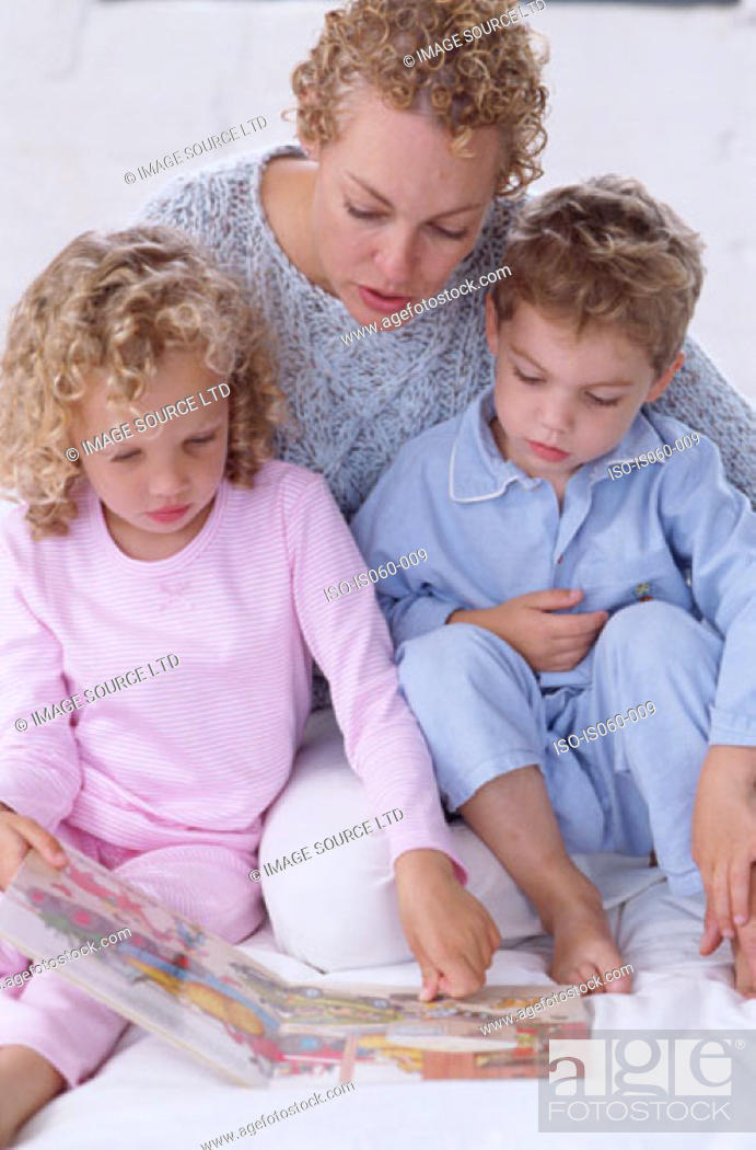 Stock Photo: Mother and kids reading.