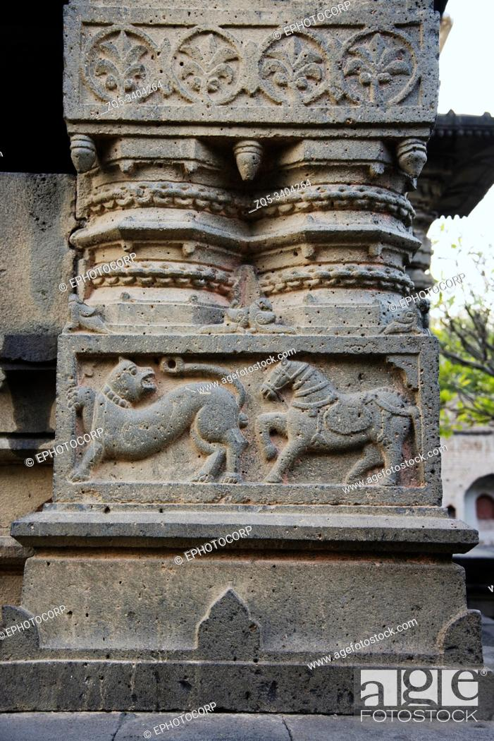 Stock Photo: Tiger and Horse figures carved on huge stone pillar, Sangmeshwar Temple in Saswad, Pune District, Maharashtra, India.