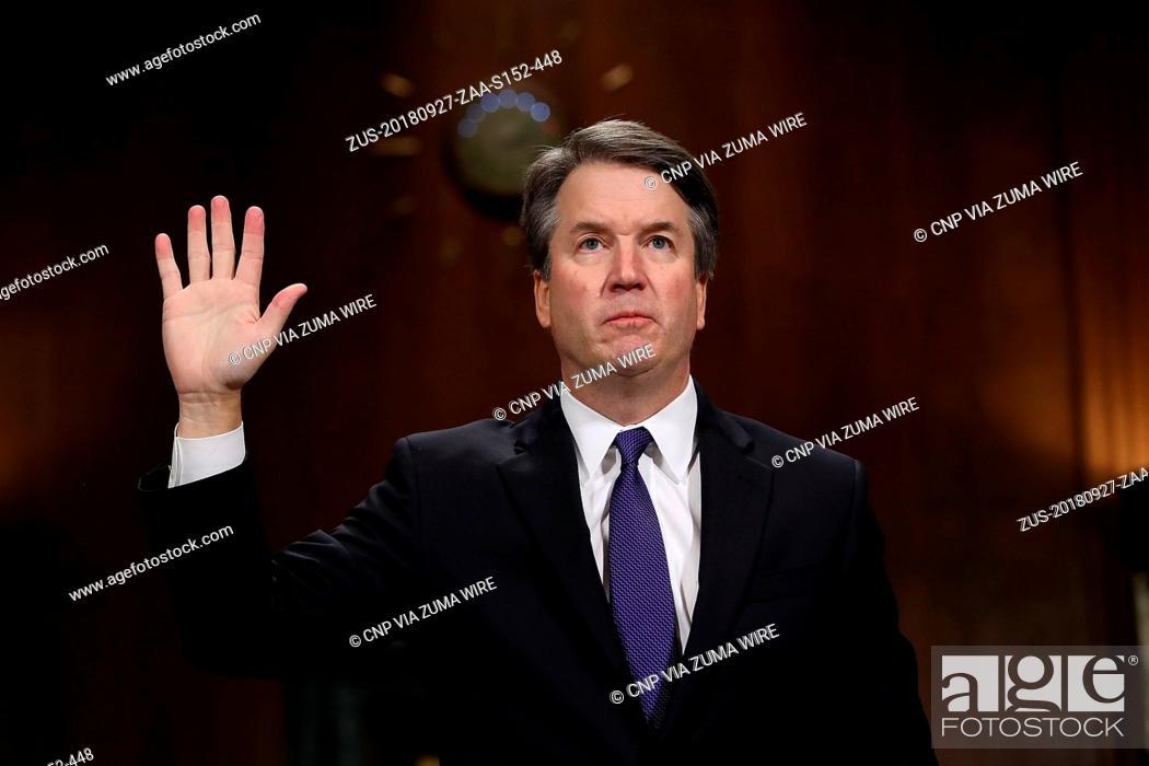 Stock Photo: September 27, 2018 - Washington, District of Columbia, U.S. - Judge Brett Kavanaugh is sworn in before testifying to the Senate Judiciary Committee during his.