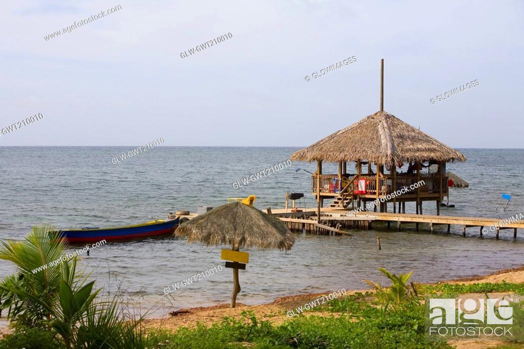 Stock Photo: Beach hut on the pier, Paya Bay Resort, Roatan, Bay Islands, Honduras.