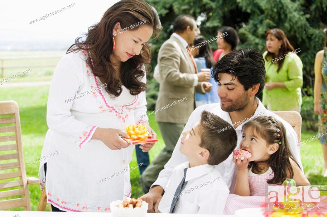 Stock Photo: Parents with children 4-7 celebrating birthday.