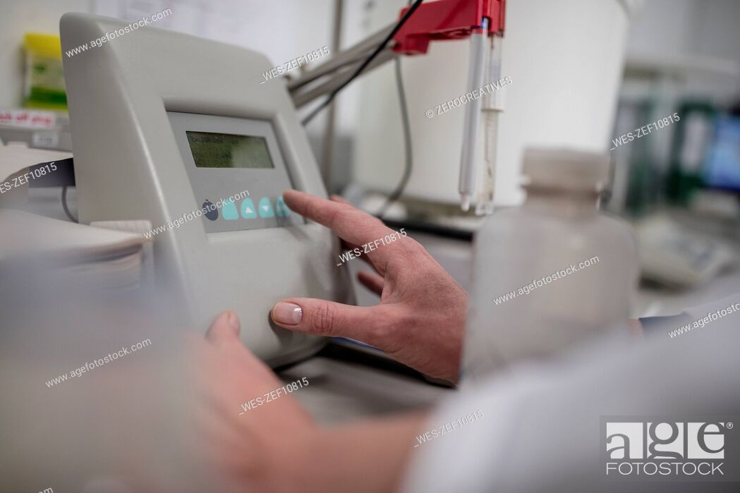 Stock Photo: Close-up of hand and equipment in lab.
