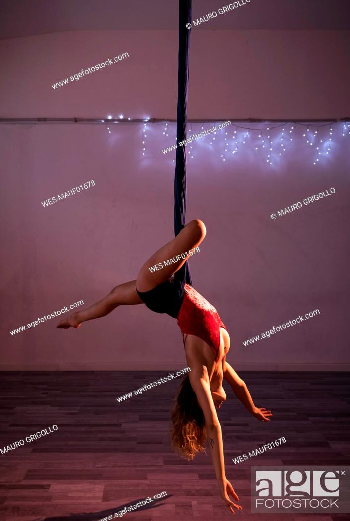 Stock Photo: Aerial silks performer during a performance.