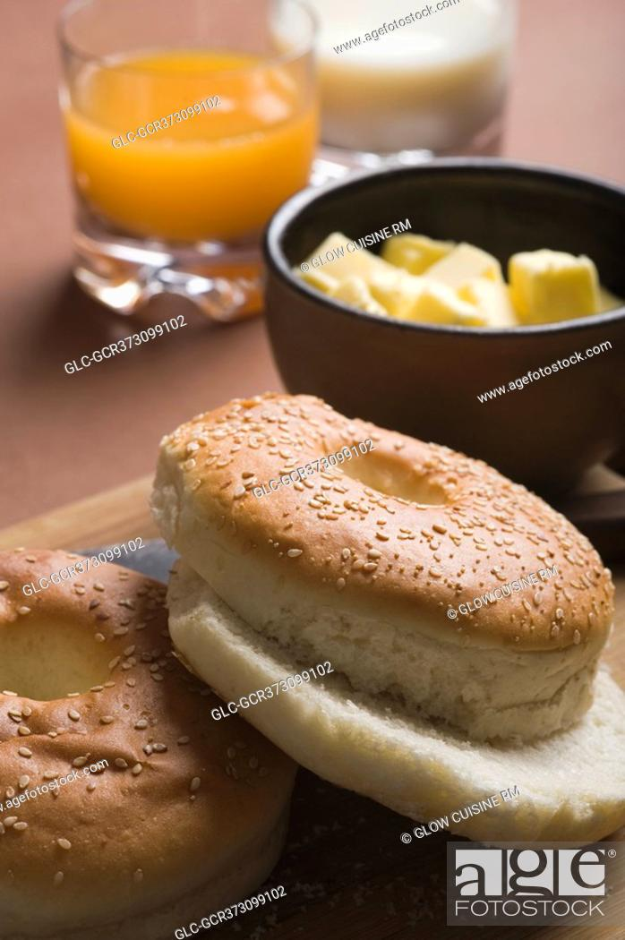 Stock Photo: Close-up of bread with butter and glasses of juice.