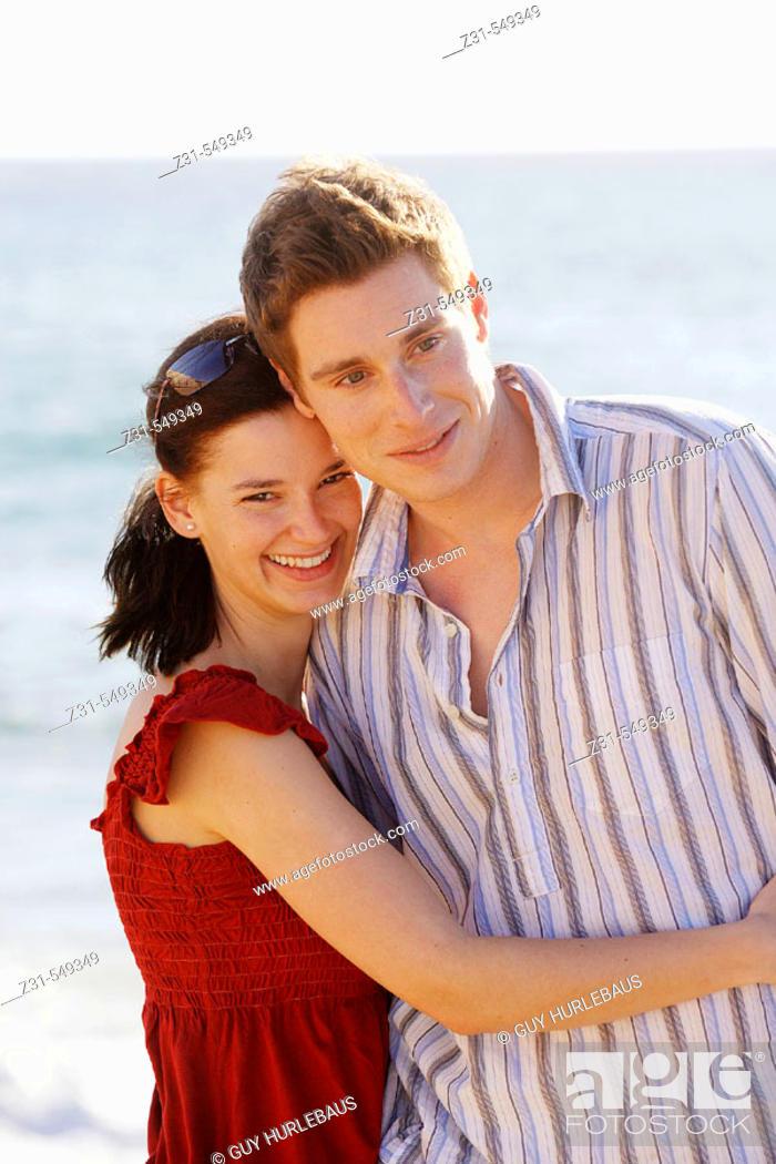 Stock Photo: Ansgar,Birgit,Embracing,Beach,Looking at camera.