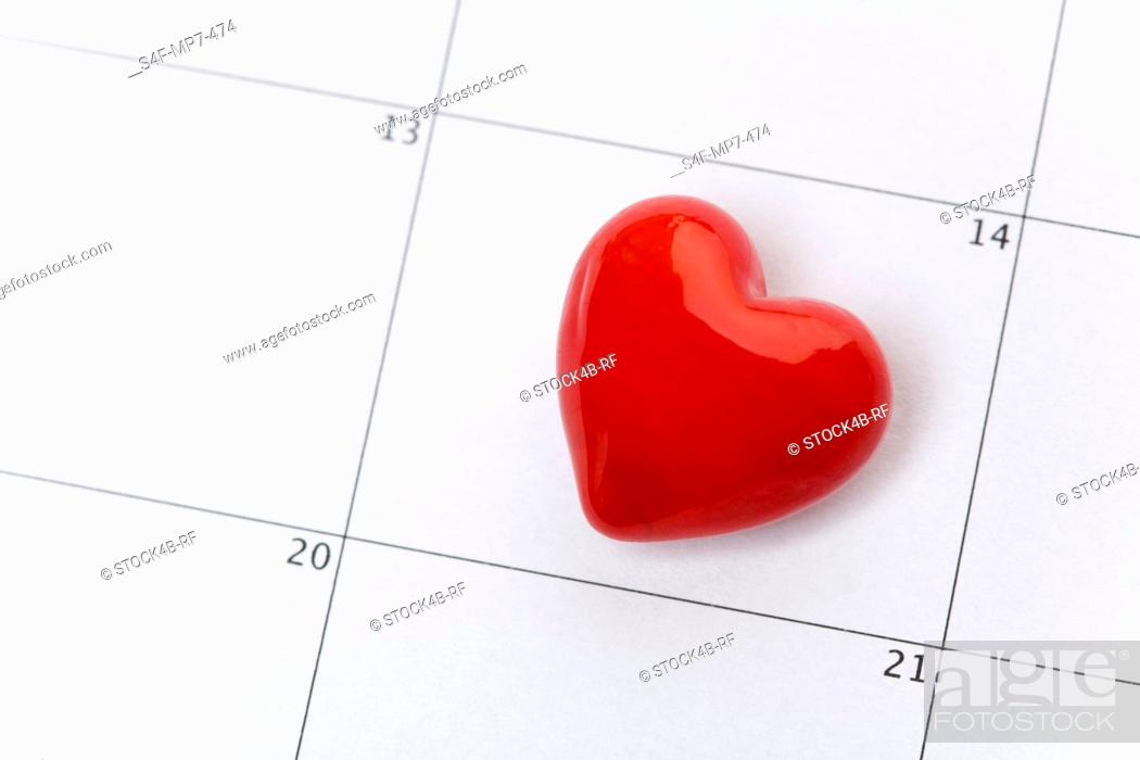 Stock Photo: Red heart on a calendar.