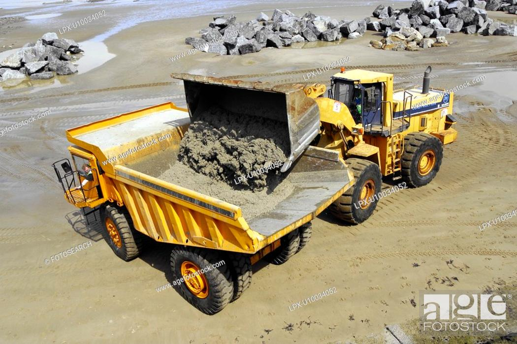 Stock Photo: Dumper Truck during construction of rock armour sea defences.