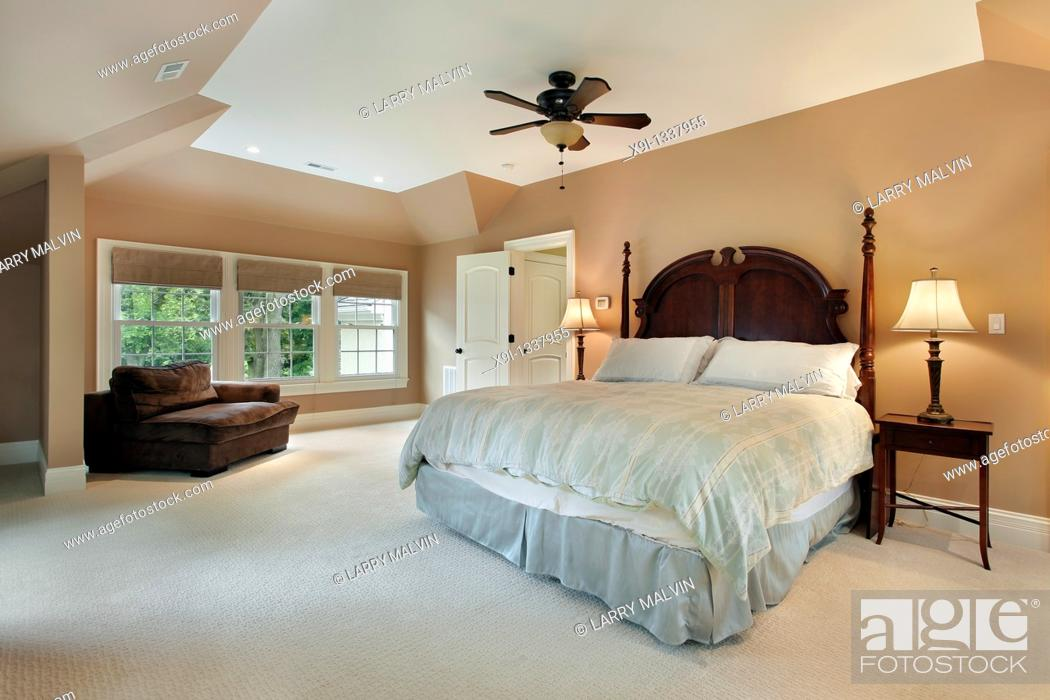 Stock Photo: Master bedroom in luxury home with tray ceiling.