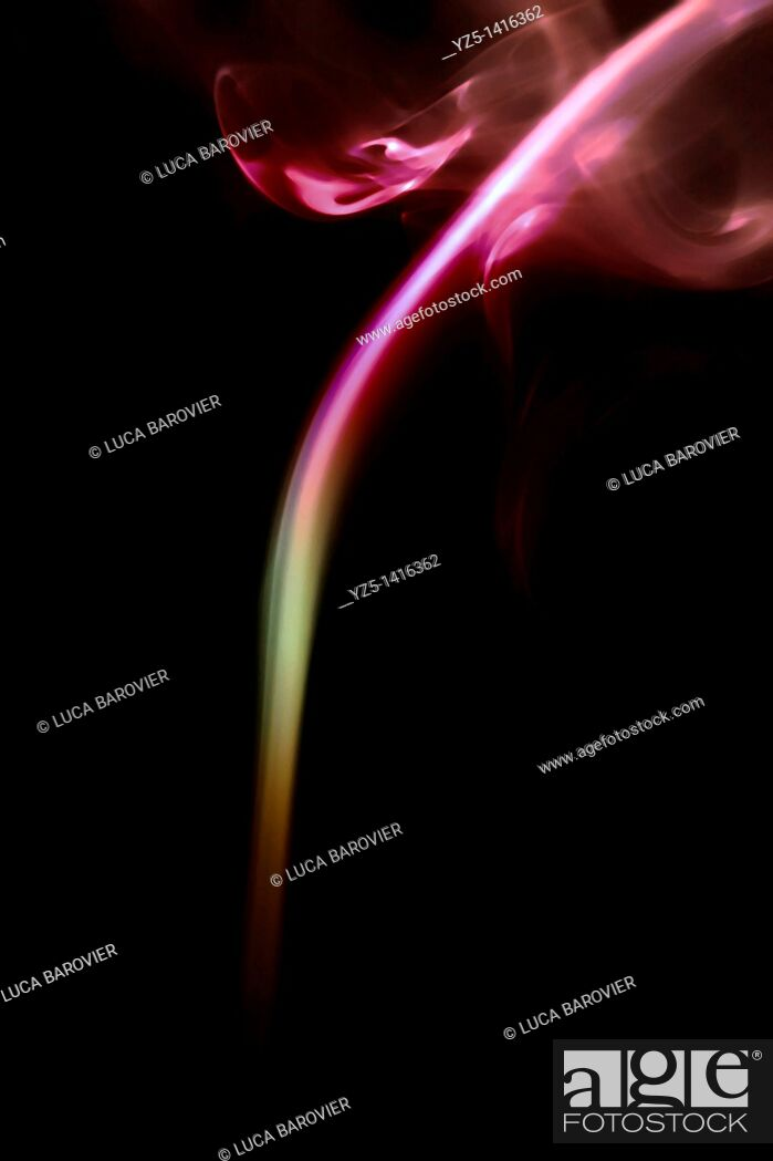 Stock Photo: Coloured incense smoke - Post production coloration.