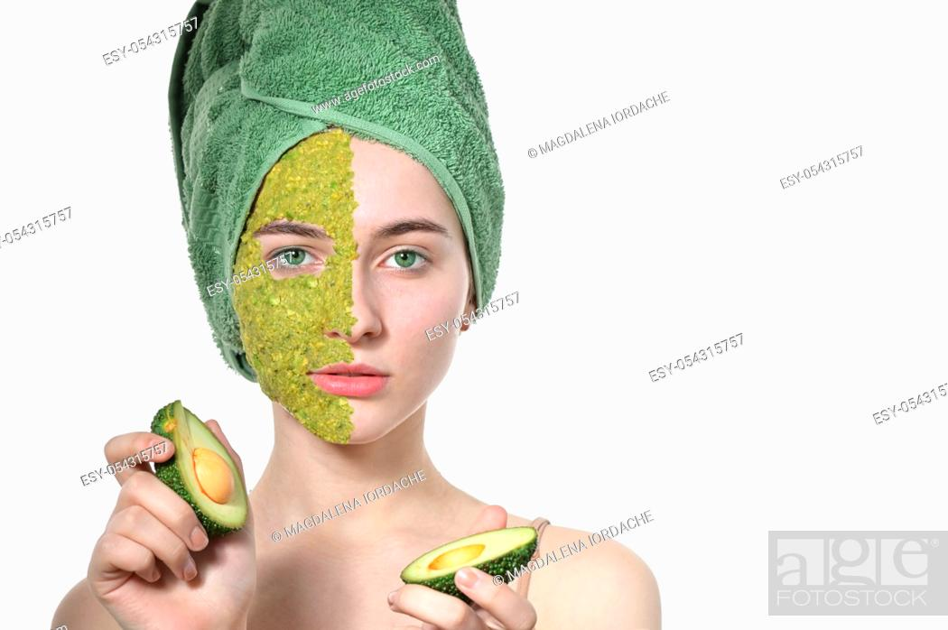 Stock Photo: Natural Cosmetics On Woman In Facial Mask With Avocado.