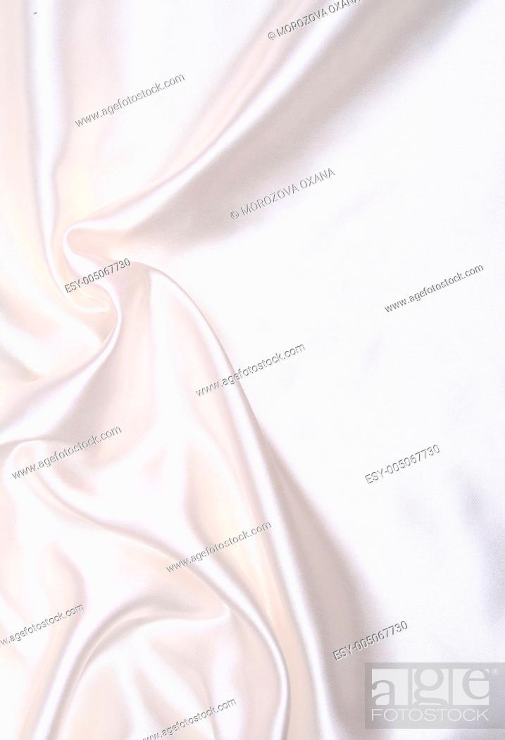 Stock Photo: Smooth elegant white silk as wedding background.