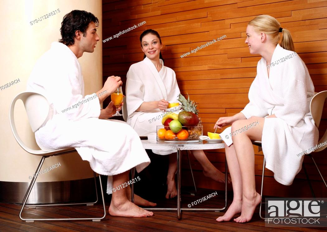 Stock Photo: Friends having a refreshment after a spa treatment.