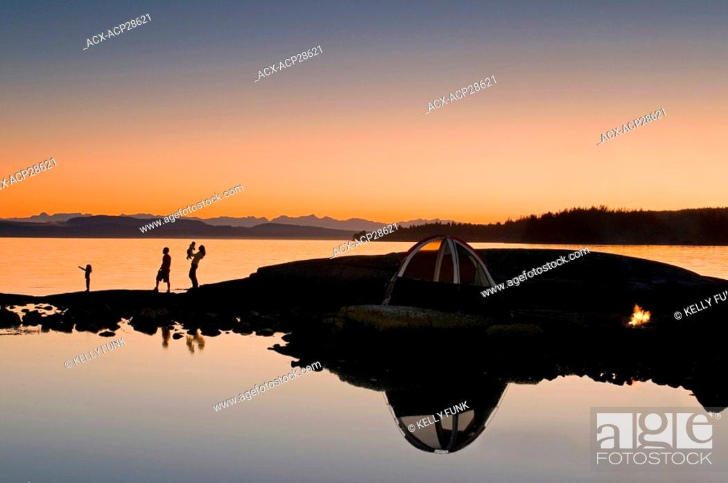Stock Photo: A family enjoys a captivating sunset while camping near Powell River, on the Sunshine coast of the Vancouver coast and mountain region of British Columbia.