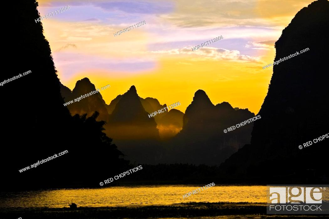 Stock Photo: Silhouette of the rocks at the riverside, Li River, XingPing, Yangshuo, Guangxi Province, China.