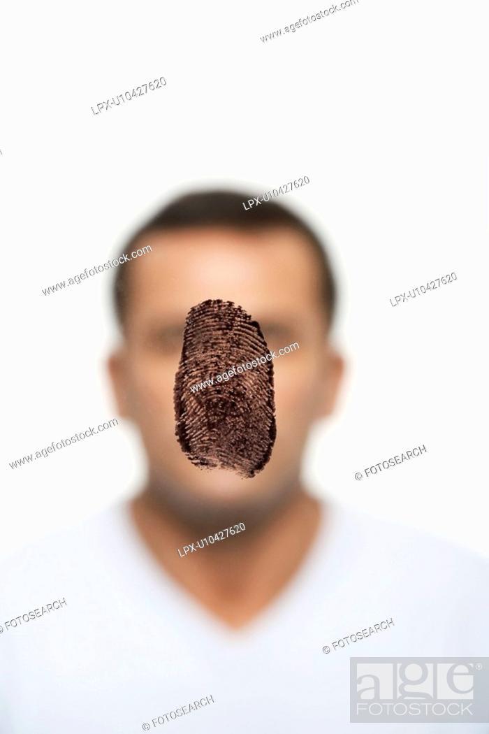 Stock Photo: Fingerprint covering man's face.