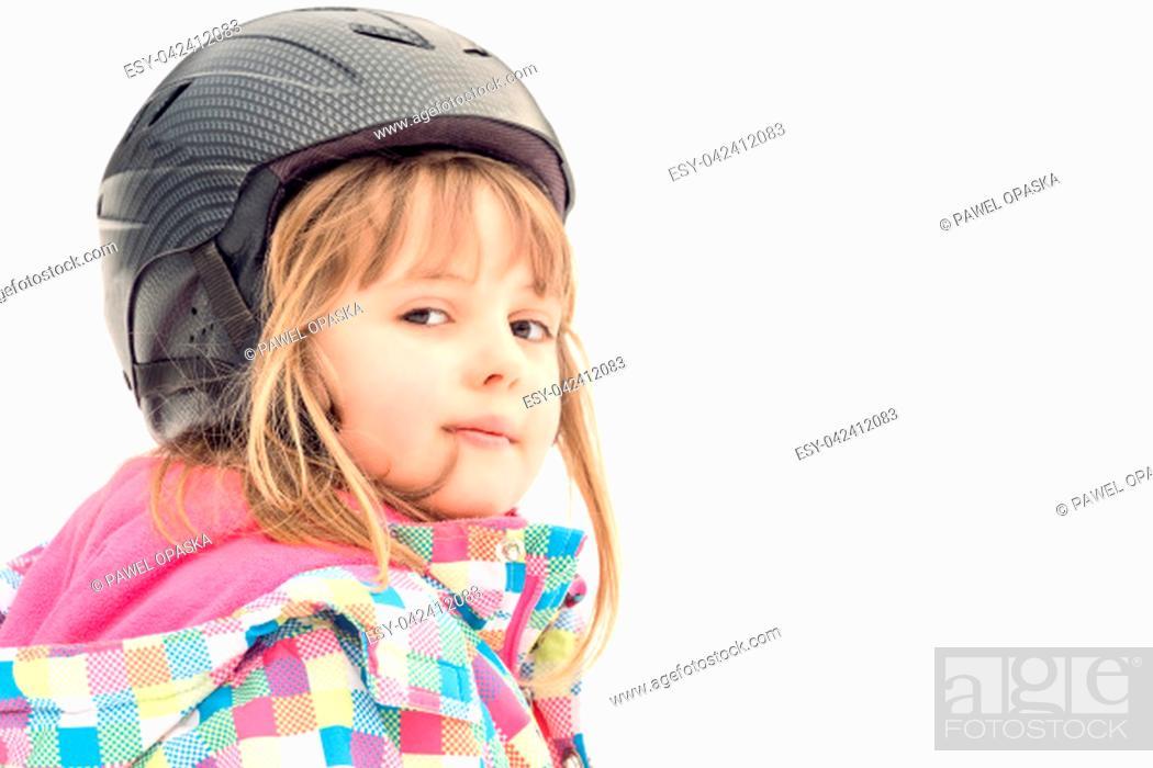 Stock Photo: Winter portrait of a little girl wearing ski helmet during skiing lesson.