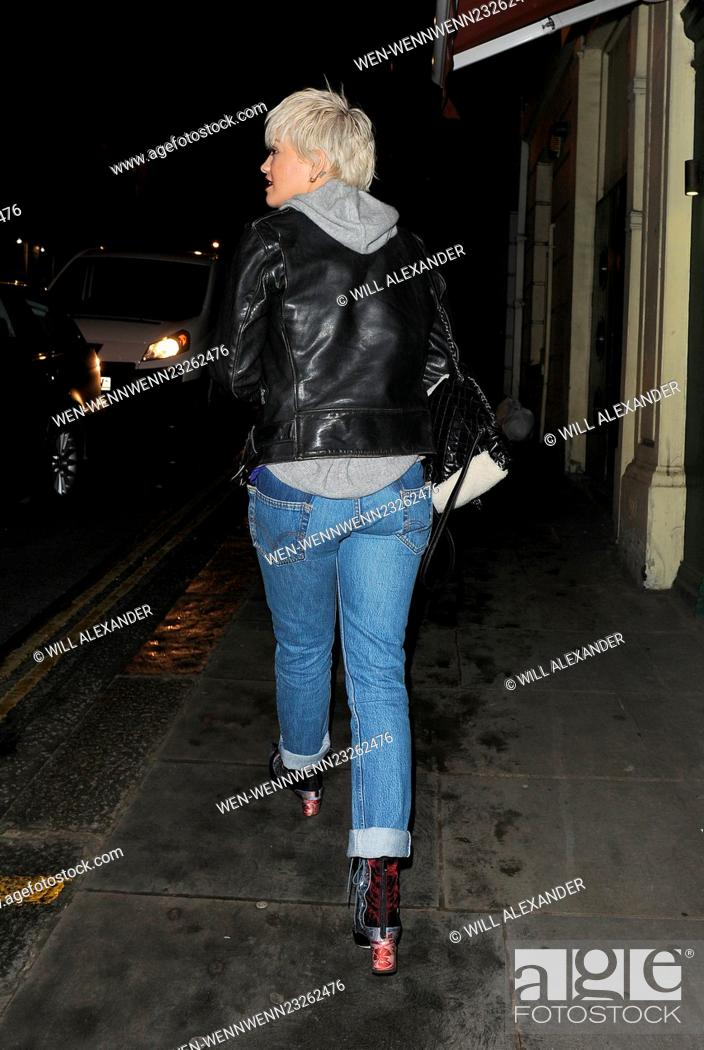 Stock Photo: Rita Ora shows off her new blonde bob haircut, as she leaves Pizza Express in Notting Hill, with sister Elena Ora, and close friend Vas J Morgan.