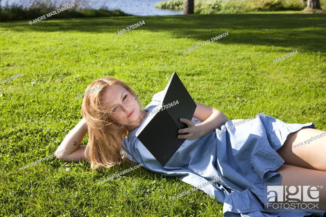Stock Photo: Elin Paulander, Miss Jämtland 2009. Woman reading outdoor.