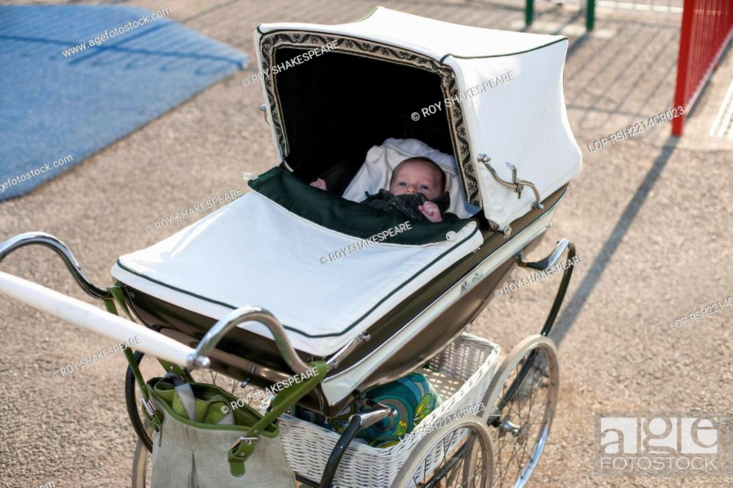 Imagen: England, Hertfordshire, Hitchin. A new born baby in an original 1950's perambulator.