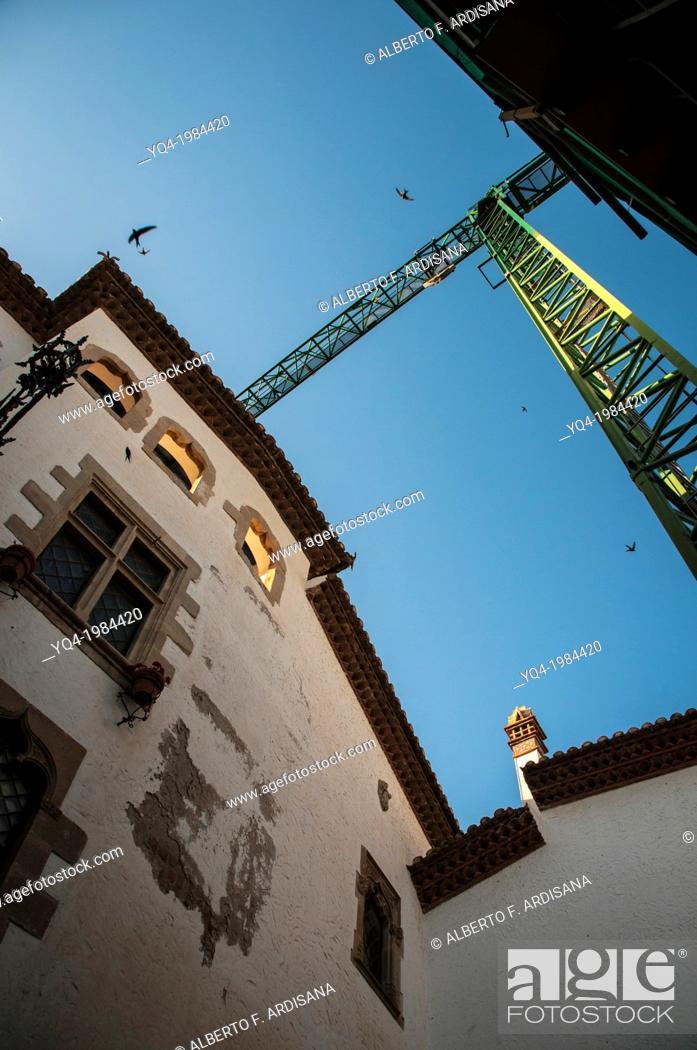 Stock Photo: Church of Sant Bartomeu i Santa Tecla (San Bartolome y Santa Tecla), crane used for restoration. Sitges, Barcelona, Spain.
