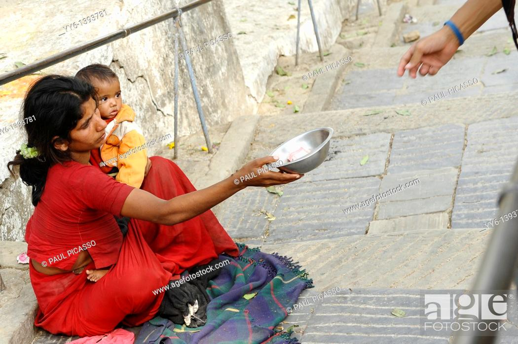 Stock Photo: mother holding her baby whilst begging for money, the nepalis , life in kathmandu , kathmandu street life , nepal.