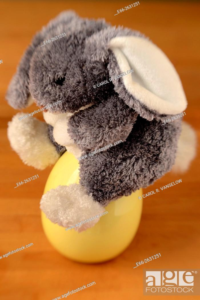 Stock Photo: Stuffed Easter bunny sitting on an egg. Shot with LensBaby for selective focus.