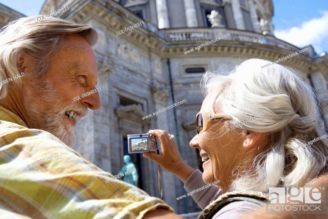 Stock Photo: Couple taking picture of church.