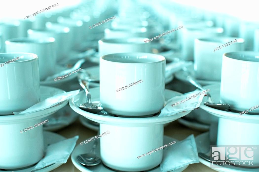 Stock Photo: Rows of stacked teacups and saucers close-up.