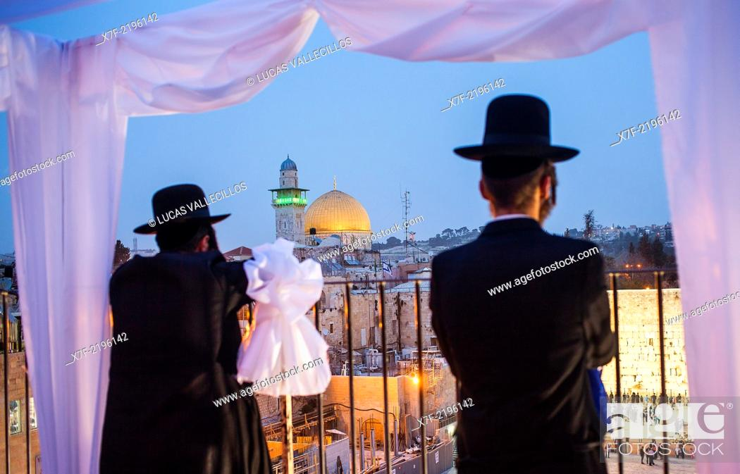 Stock Photo: Orthodox Jews observing, the Wailing Wall and Dome of the Rock, Old City, Jerusalem, Israel.