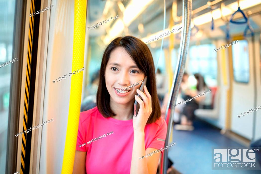 Stock Photo: Woman talk to cellphone at train compartment.