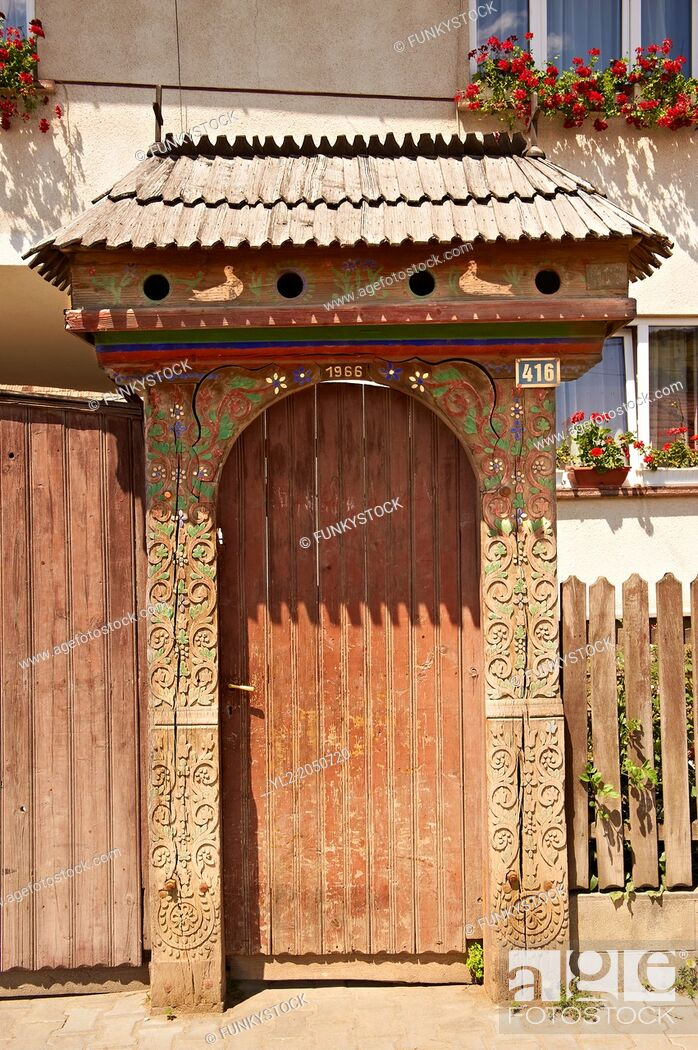 Stock Photo: Traditional wooden Szekely gates in a Szekely village near Cluj, Eastern Transylvania. Carved with folk art & painted the Szekely gate also has dove cotes above.