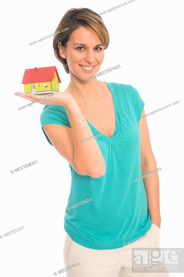 Stock Photo: Woman holding house.