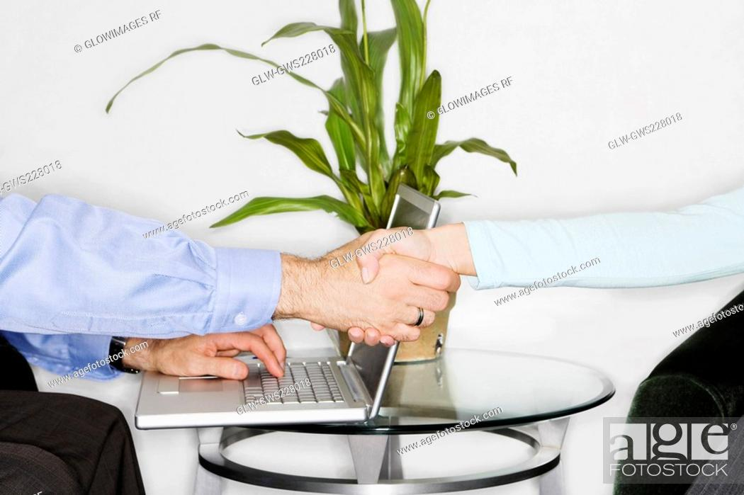 Stock Photo: Close-up of two businessmen shaking hands.