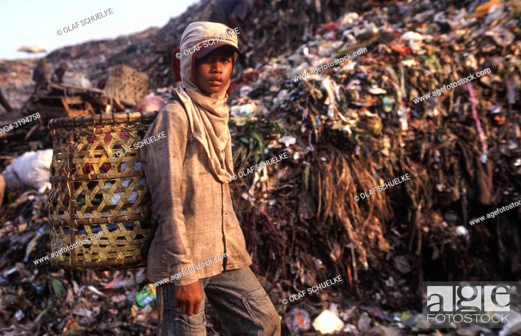Stock Photo: Jakarta, Java, Indonesia, Asia - An Indonesian garbage collector is searching for recyclable materials like plastic and metal at the Bantar Gebang garbage dump.