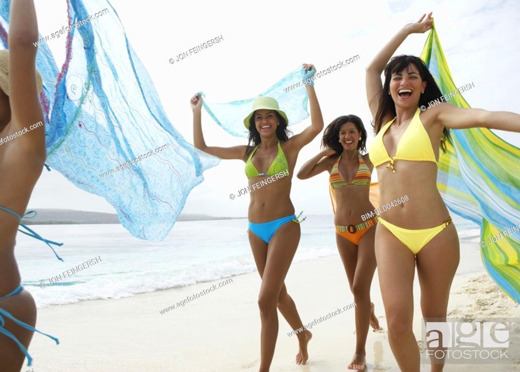 Stock Photo: South American women running on beach.