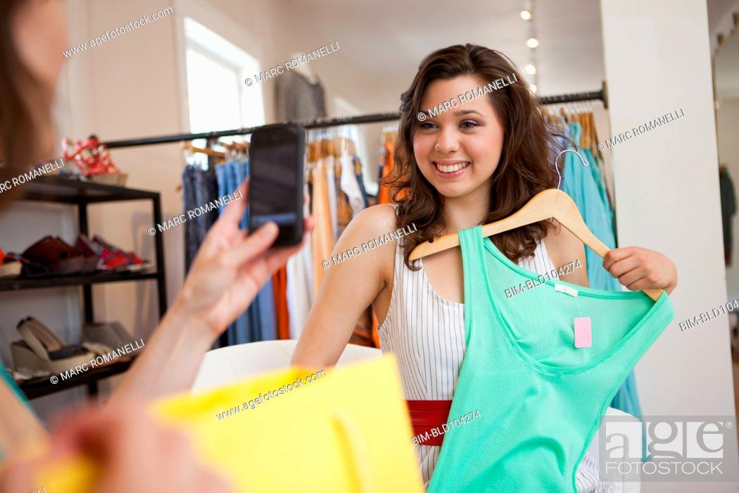 Stock Photo: Hispanic friends shopping in clothing store.
