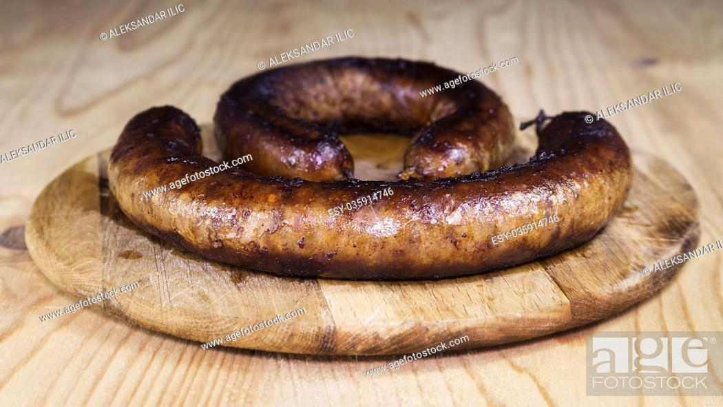 Stock Photo: Fried Sausages On a Wooden Board.