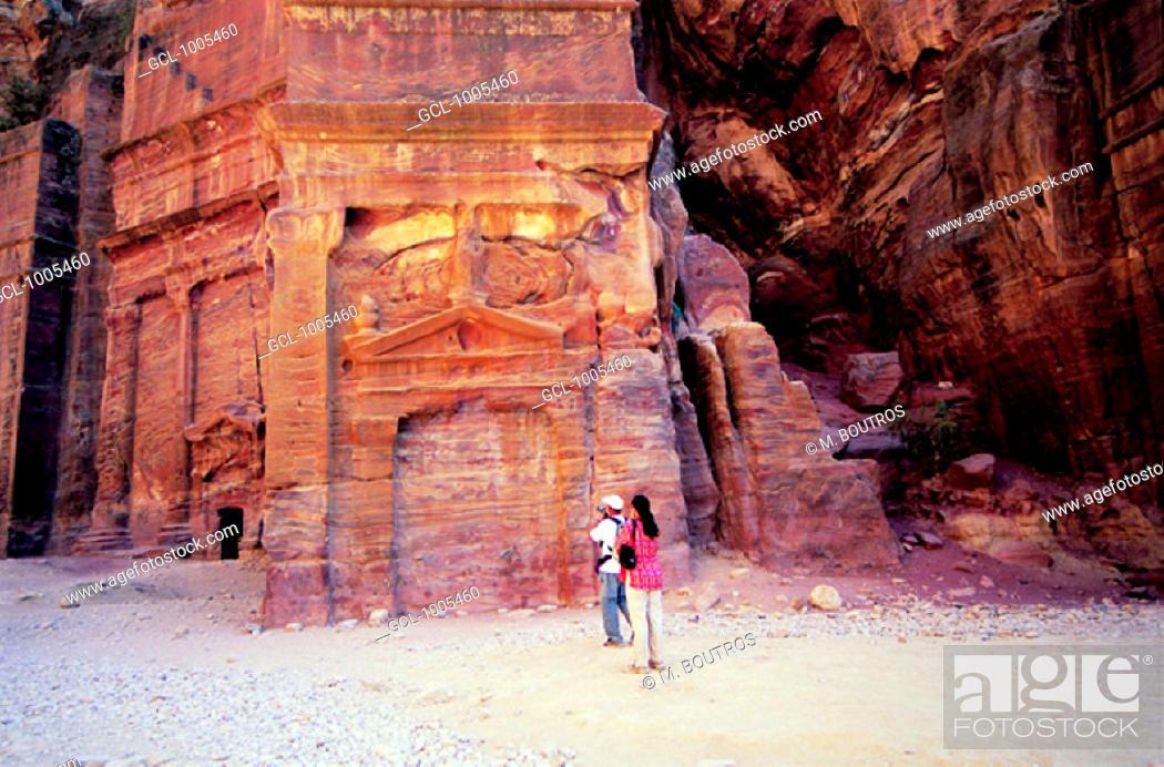 Stock Photo: Tourists visiting the historical site of Petra, Jordan.