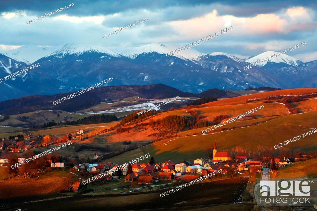 Stock Photo: Village in Turiec region with view of Mala Fatra mountain range.