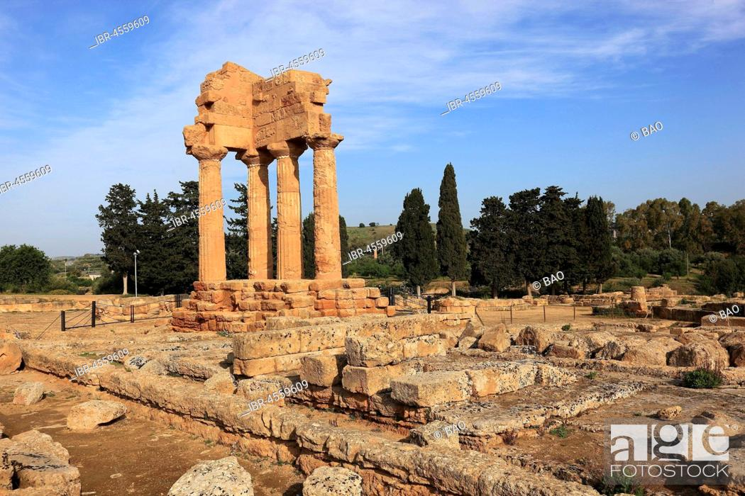 Stock Photo: Remains of theTemple of the Dioscuri, Tempio di Dioscuri, ancient city of Akragas, Valley of the Temples, Agrigento, Sicily, Italy.